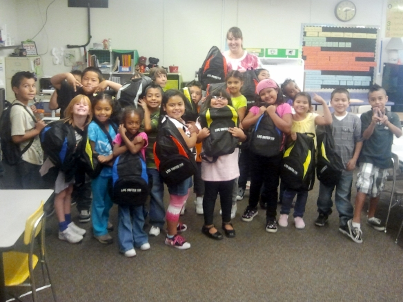Lincoln Elem students with backpacks from Stuff the Bus