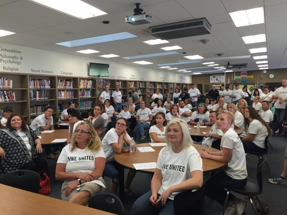 CHG employees gather at Kearns Jr. High School in preparation to tutor students during United Way of Salt Lake's annual Day of Caring
